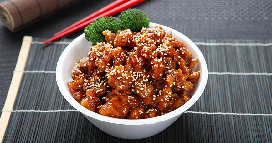 Teriyaki chicken in a bowl with chopsticks