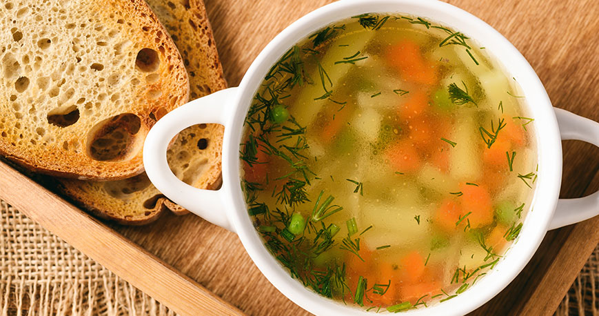 Chicken soup in bowl with bread