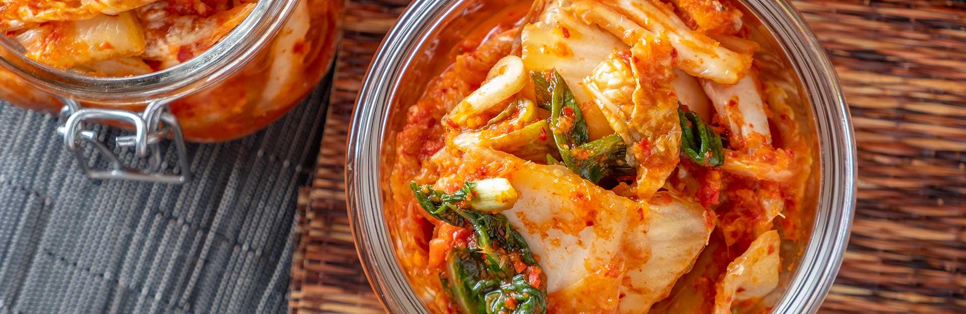 Jars of kimchi sitting on a table