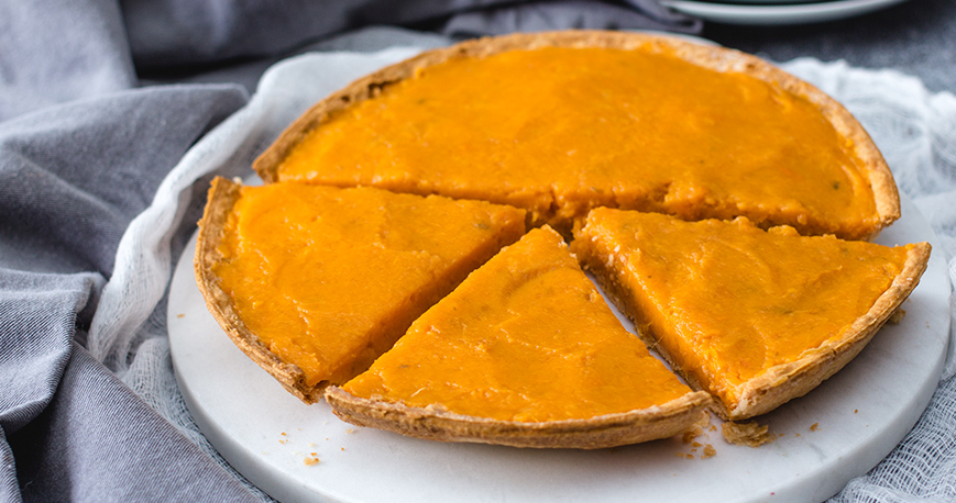 sliced sweet potato pie presented on a plate