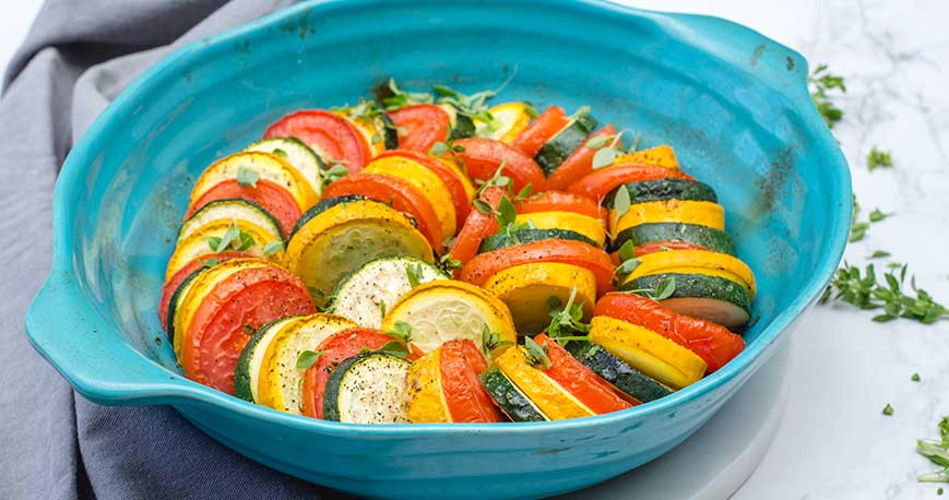 Baked vegetables in a blue serving dish