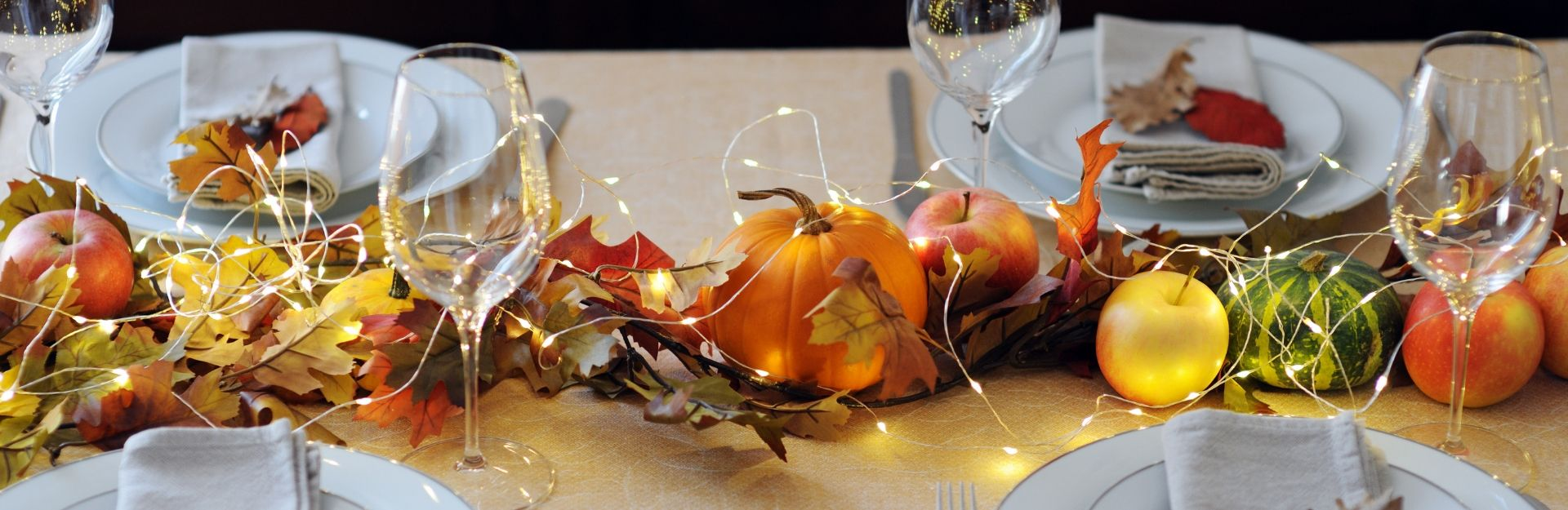 A festive table setting for a fall dinner.