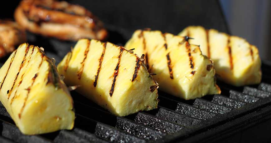 pineapple on a grill: one of the key ingredients for an easy fruit salad recipe