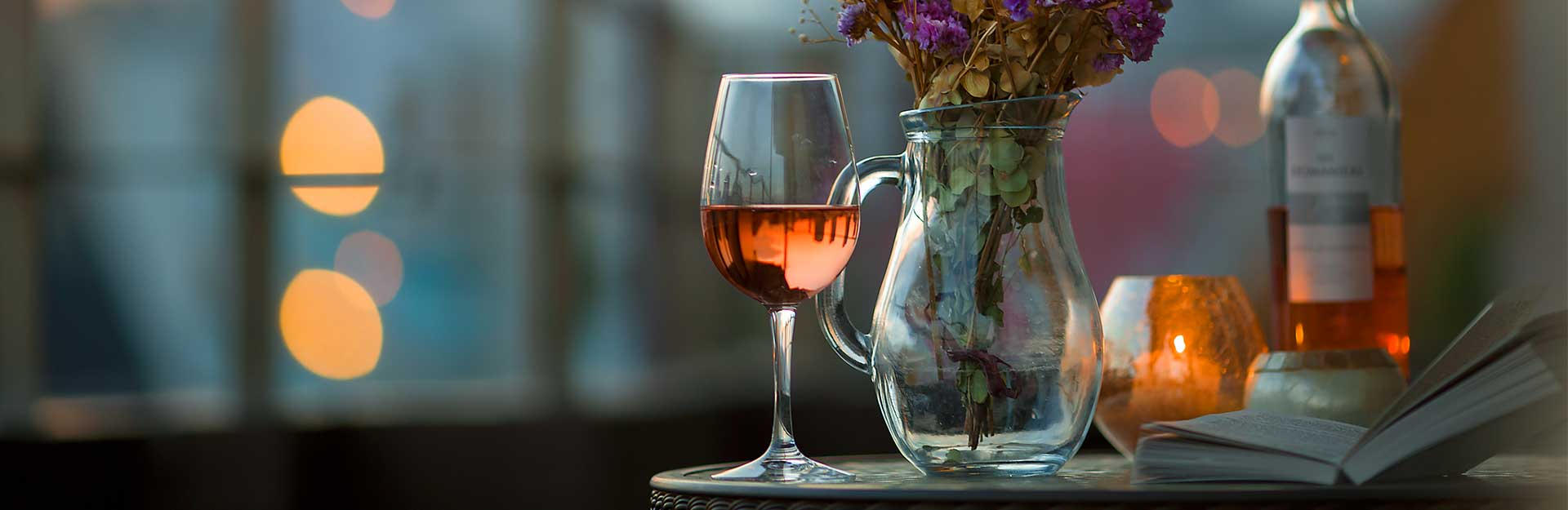 a glass of wine on a table